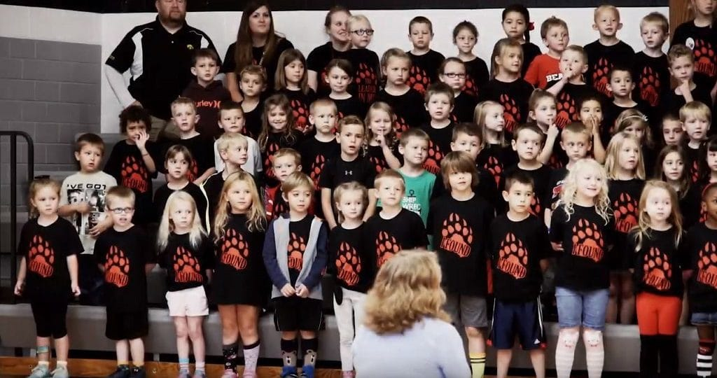 Children perform in a school choir.
